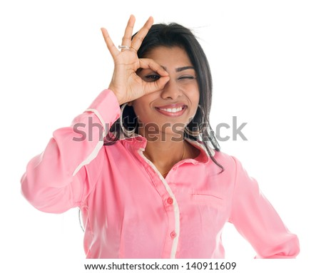 Indian businesswoman focused by hand hole. Portrait of beautiful Asian female model standing isolated on white background. - stock photo