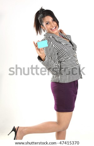 Indian businesswoman  with credit card - stock photo
