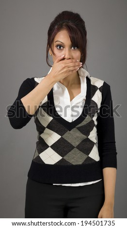 Indian businesswoman with hand over her mouth - stock photo