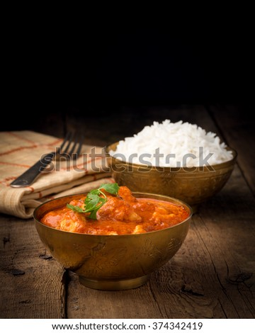 Indian butter chicken photographed with a low key background. - stock photo
