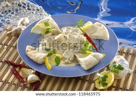 Indian catfish on porcelain plate - stock photo