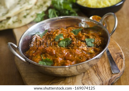 Indian chicken Balti with pilau rice and naan - stock photo
