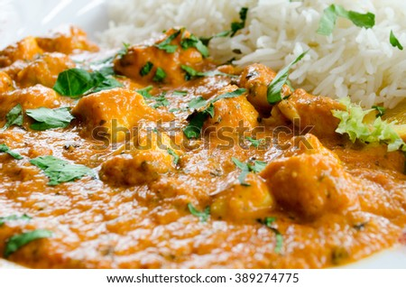 Indian chicken curry, with basmati rice, topped with coriander. - stock photo