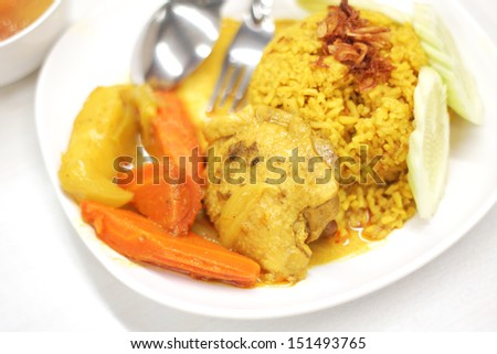 Indian chicken curry with pilau rice - stock photo
