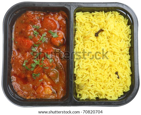 Indian chicken curry with rice in supermarket packaging tray. - stock photo