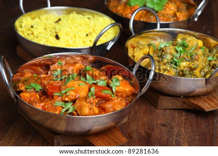 Indian chicken jalfrezi with rice and vegetable curry. - stock photo