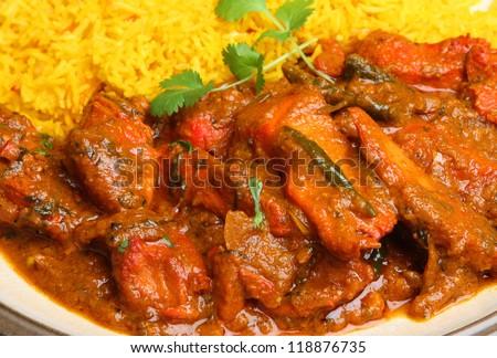 Indian chicken tikka jalfrezi curry with pilau rice - stock photo