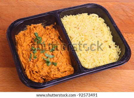 Indian chicken tikka masala curry with rice ready meal - stock photo