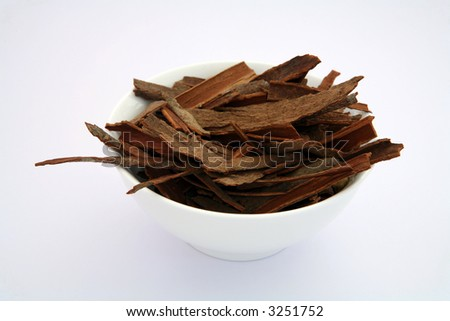 Indian Cinnamon sticks (cassia bark) in a white bowl.