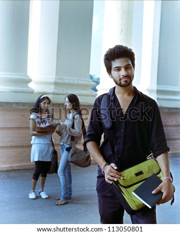 Indian college student smiling in the campus. - stock photo