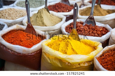 Indian colorful spices at Anjuna flea market in Goa, India - stock photo