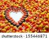 Indian corn heart among candy corn - stock