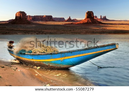 Indian country boat tied at Navajo river bank in Monument Valley - stock photo