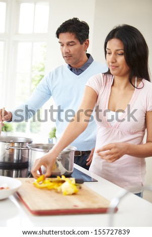 Indian Couple Cooking Meal At Home