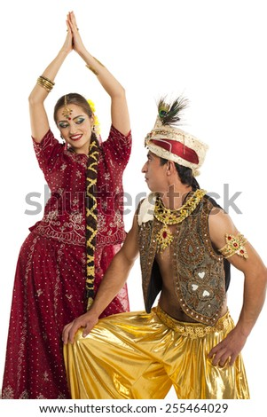 Indian couple. Portrait of beautiful Indian family in traditional costume standing isolated on white background. Indian husband and wife model. - stock photo