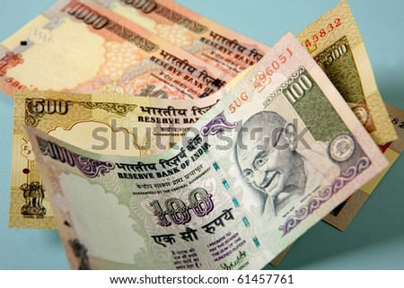 Indian currency banknotes, focus is on center of 100 rupee note, 1ds image - stock photo