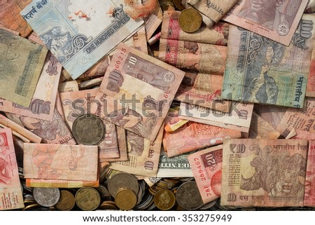 Indian currency notes and coin in the donation box. Process in more contrast tone. - stock photo