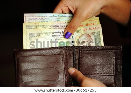 Indian currency notes in a wallet