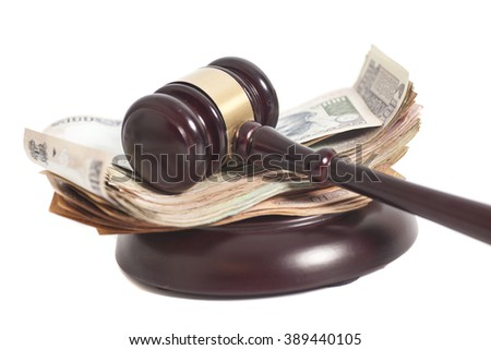 Indian Currency Rupee Notes with Law Gavel isolated on white - stock photo