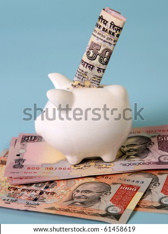 indian currency with piggy bank, saving concept - stock photo