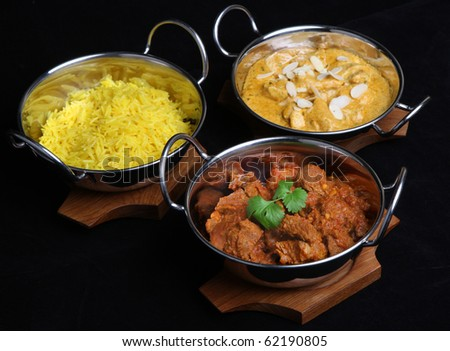 Indian curries and rice. - stock photo