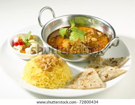 Indian curry served with rice and naan - stock photo