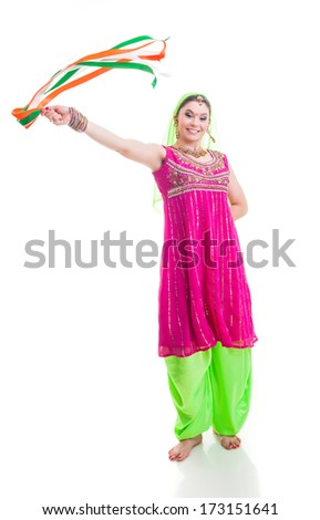 Indian dancer in traditional beautiful green and pink dress with veil and tassels