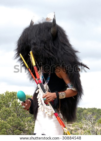 Indian dancer performing the Buffalo Dance during religious ceremony - stock photo