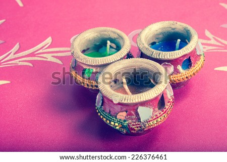 indian decorative candle pot, indian traditional festival retro style - stock photo