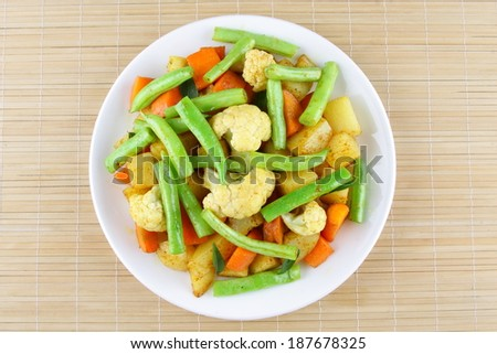 Indian dish of potato,carrots,bean s cooked with spices.  - stock photo