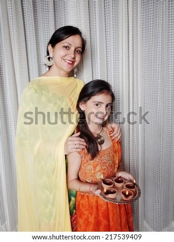 Indian family celebrating Deepawali in India. - stock photo