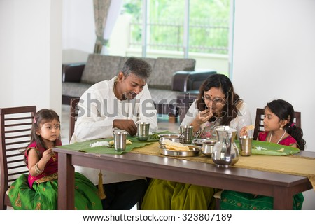 indian family having a meal - stock photo