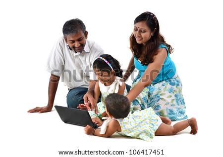 indian family on laptop - stock photo