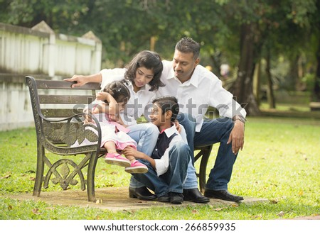 indian family outdoor - stock photo