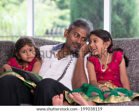 indian father with his daughter on phone conversation lifestype photo - stock photo