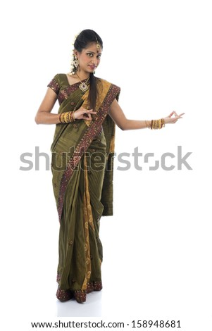indian female dancer dancing in white background  - stock photo