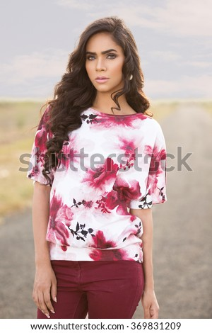 Indian female fashion model posing for a photoshoot - stock photo