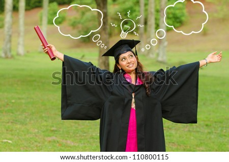 indian female graduate thinking about future prospects - stock photo