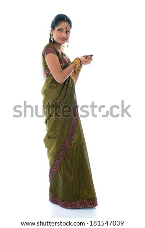 indian female in traditional clothes with lamp full body - stock photo