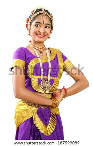 Indian female performing Bharathanatyam doing the action of admiring  in violet color costumes  - stock photo
