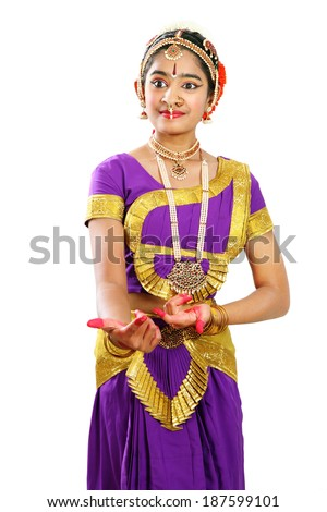 """Indian female performing Bharathanatyam doing the action of """"come quickly""""  in violet color costumes  - stock photo"""