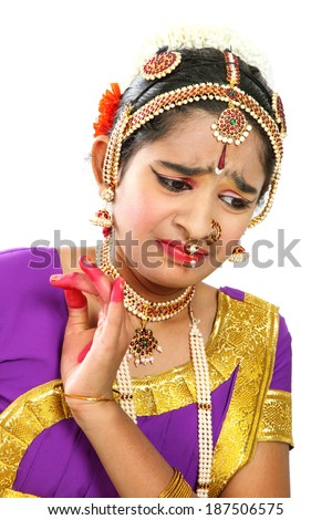 Indian female performing Bharathanatyam doing the action of  distress  in violet  color costumes. - stock photo