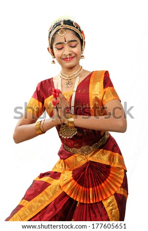 Indian female performing Bharathanatyam  doing the action of peace or shantha - stock photo