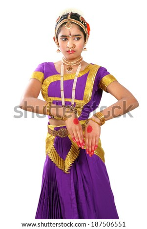Indian female performing Bharathanatyam doing the action of showing agitation in violet  color costumes. - stock photo