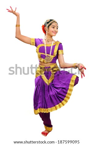 Indian female performing Bharathanatyam doing the action of showing water falls in violet color costumes  - stock photo