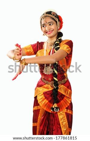 Indian female performing Bharathanatyam doing the action of tripura sundari / kamakshi - stock photo