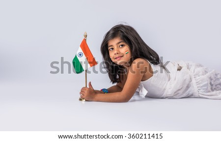 indian flag and cute little indian girl, 4 year indian girl with indian flag or tricolour, india flag & girl, girl holding indian flag, indian independence day, indian republic day, isolated on white - stock photo
