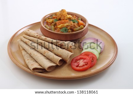 Indian flat-bread called chapati with vegetable curry - stock photo