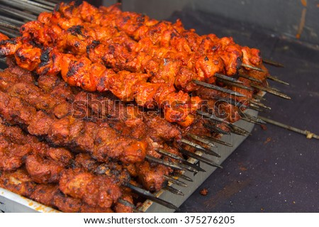 Indian food. Chicken tikka and chicken tikka hariyali on charcoal grill. Outdoor Indian Food festival - stock photo