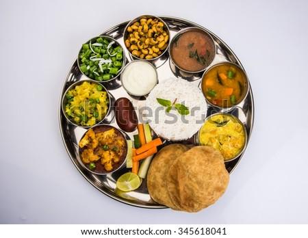 indian food platter, indian thali, indian veg thali,paratha, rice, aalu bhaji,puri or poori, complete meal, south indian thali - stock photo